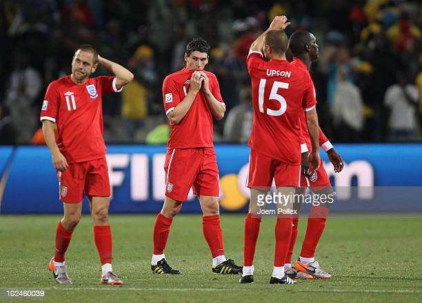 Joe Cole, Gareth Barry and Matthew Upson of England look dejected, after suffering defeat to Germany, following the 2010 FIFA World Cup South Africa...