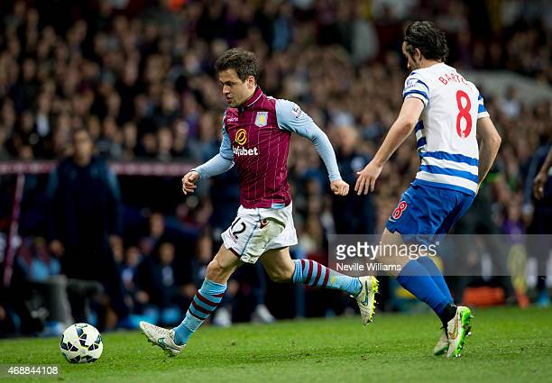 Joe Cole of Aston Villa is challenged by Joey Barton of Queens Park Rangers during the Barclays Premier League match between Aston Villa and Queens...