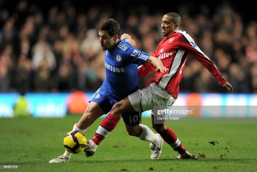 Joe Cole of Chelsea and Gael Clichy of Arsenal battle for the ball during the Barclays Premier League match between Chelsea and Arsenal at Stamford Bridge on February 7, 2010 in London, England.