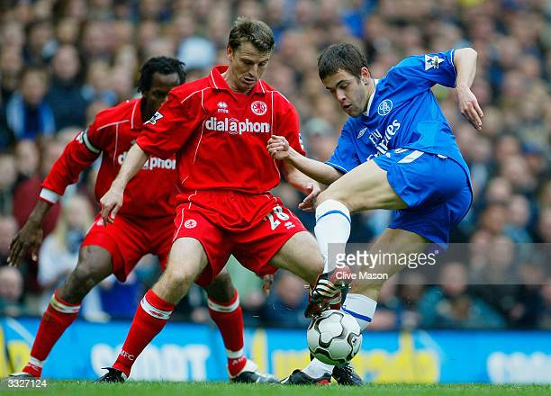 Joe Cole of Chelsea battles for the ball with Colin Cooper of Middlesbrough during the FA Barclaycard Premiership match between Chelsea and...