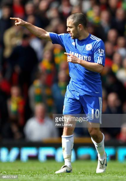 Joe Cole of Chelsea celebrates scoring the opening goal during the Barclays Premier League match between Manchester United and Chelsea at Old...