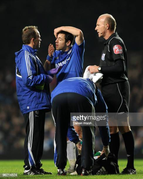 Joe Cole of Chelsea changes a contact lense during the Barclays Premier League match between Chelsea and Birmingham City at Stamford Bridge on...