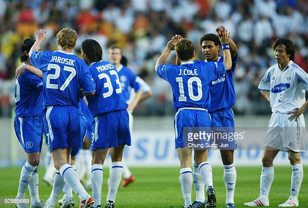 Joe Cole of Chelsea FC celebrates with team mates after scoring during a friendly match between Chelsea and Suwon Samsung Bluewings on May 20 2005 in...