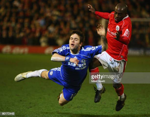 Joe Cole of Chelsea is tripped by Jamal Campbell-Ryce of Barnsley during the FA Cup sponsored by E.ON 6th Round match between Barnsley and Chelsea at...