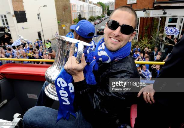 Joe Cole of Chelsea poses with the FA Cup trophy during the Chelsea Football Club Victory Parade on May 16 2010 in London England