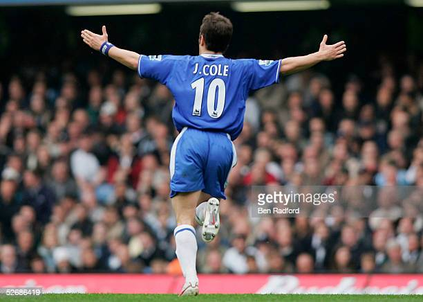 Joe Cole of Chelsea runs towards the bench in celebration after scoring the first goal of the game during the Barclays Premiership match between...