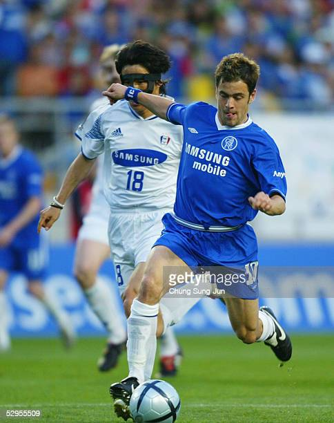 Joe Cole of Chelsea shoots and scores his club's only goal during a friendly match with Suwon Samsung Bluewings on May 20, 2005 in Suwon, South...