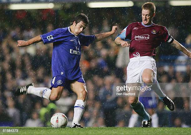 Joe Cole of Chelsea shoots past Steve Lomas of West Ham during the Carling Cup Third Round match between Chelsea and West Ham United at Stamford...