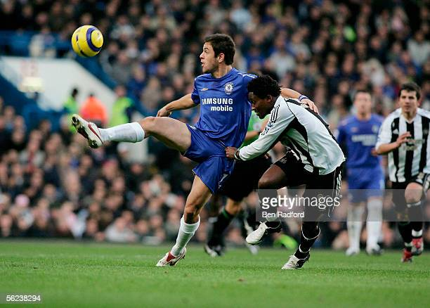 Joe Cole of Chelsea tussles for posession with Celestine Babayaro of Newcastle during the Barclays Premiership Match between Chelsea and Newcastle...