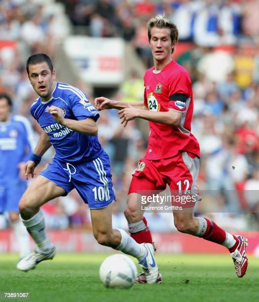 Joe Cole of Chelsea tussles for posession with Morten Gamst Pedersen of Blackburn Rovers during the FA Cup sponsored by EON Semi Final match between...