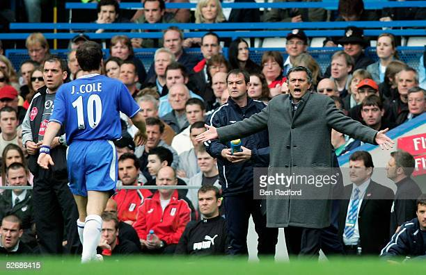 Joe Cole of Chelsea walks over to the bench to listen to Manager Jose Mourinho after scoring the first goal of the game during the Barclays...