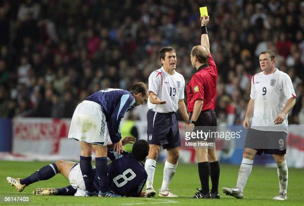 Joe Cole of England appeals as he is booked by referee Philippe Leuba during the International friendly match between England and Argentina at the...