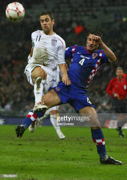 Joe Cole of England battles with Robert Kovac of Croatia during the Euro 2008 Group E qualifying match between England and Croatia at Wembley Stadium...