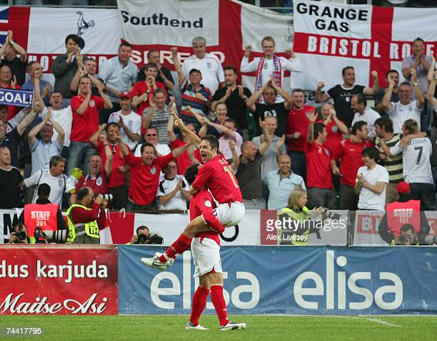 Joe Cole of England celebrates his goal with Wayne Bridge during the Euro 2008 qualifying match between Estonia and England at the ALe Coq Arena on...