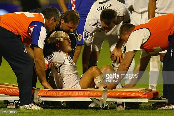 Joe Cole of England is helped on to a stretcher after injuring himself during the FIFA 2010 World Cup Qualifying Group Six match between Croatia and...