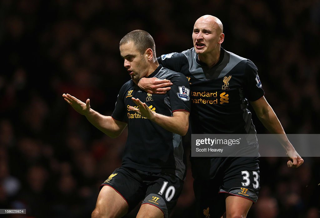 Joe Cole (L) of Liverpool celebrates his goal with Jonjo Shelvey during the Barclays Premier League match between West Ham United and Liverpool at the Boleyn Ground on December 9, 2012 in London, England.
