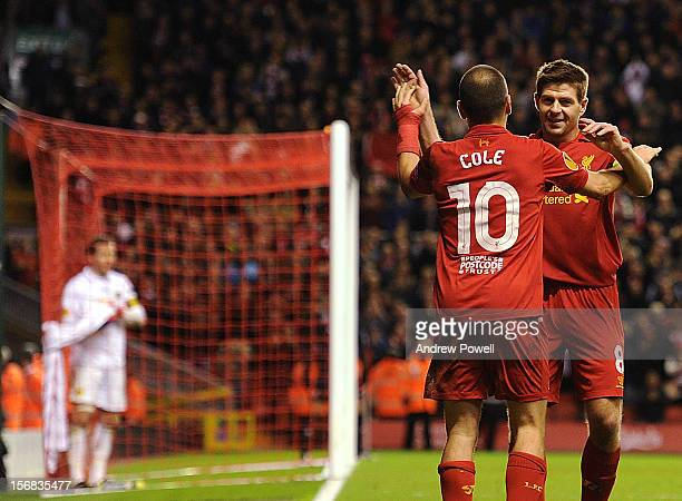 Joe Cole of Liverpool celebrates his goal with Steven Gerrard during the UEFA Europa League Group A match between Liverpool and BSC Young Boys at...