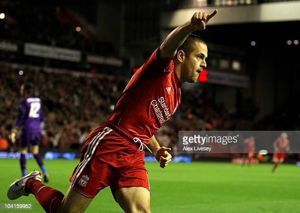 Joe Cole of Liverpool celebrates scoring the opening goal during the UEFA Europa League Group K match beteween Liverpool and Steaua Bucharest at...