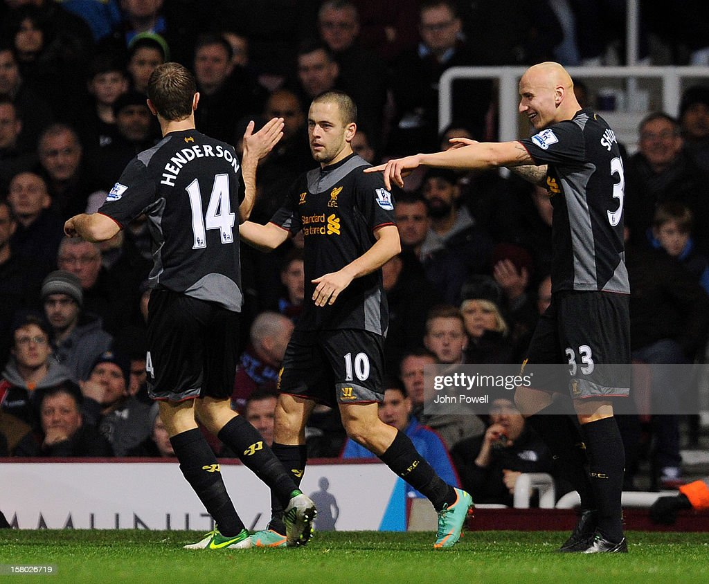 Joe Cole (C) of Liverpool celebrates with his team-mates Jordan Henderson (L) and Jonjo Shelvey (R) after scoing their second goal during the Barclays Premier League match between West Ham United and Liverpool at Boleyn Ground on December 9, 2012 in London, England.