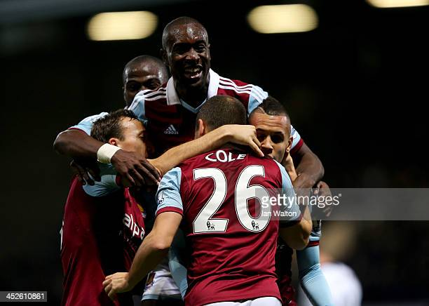 Joe Cole of West Ham United is congtratulated by team mates as he socres their third goal during the Barclays Premier League match between West Ham...