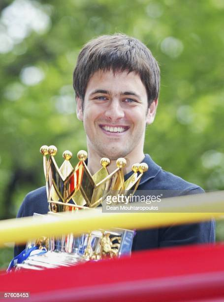 Joe Cole shows the Premiership Trophy to the fans on the opentopped bus parade of the Barclays Premiership trophy and the FA Community Shield as they...