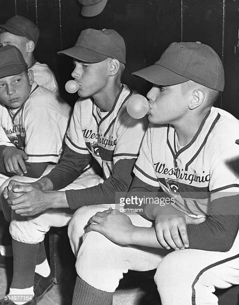 Joe Cook and Jack Moran of West Virginia's Fairmont blow bubbles while sitting in the dugout during the 1951 Little League World Series