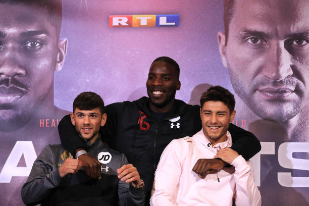 Joe Cordina and Joshua Kelly pose for photos with Lawrence Okolie, prior to their fight as Anthony Joshua and Wladamir Klitschko take part in a press...