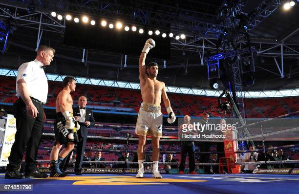 Joe Cordina celebrates after defeating Sergej Vib in the first round of the Super Featherweight bout at Wembley Stadium on April 29 2017 in London...