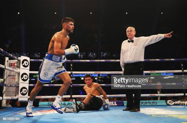 Joe Cordina is ushered to a neutral corner as he knocks down Lester Cantillano during their Lightweight contest at Principality Stadium on October 28...