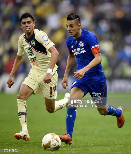 Joe Corona of America vies for the ball with Carlos Alvarado of Cruz Azul during the first round of final of the Mexican Apertura tournament football...