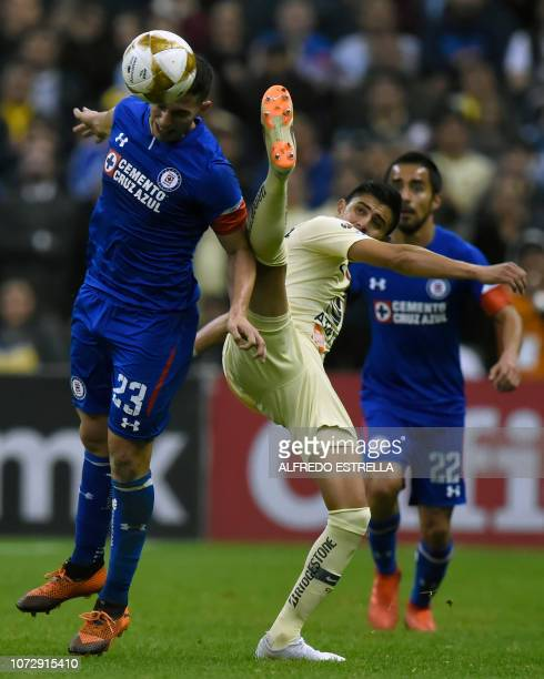 Joe Corona of America vies for the ball with Ivan Marcone of Cruz Azul during the first round of final of the Mexican Apertura tournament football...