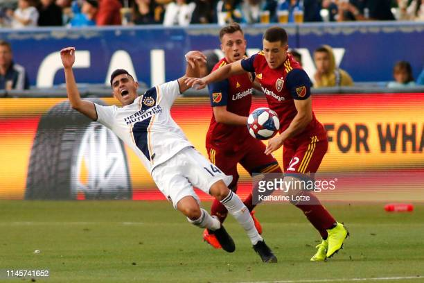 Joe Corona of Los Angeles Galaxy yells as he falls after a foul by Aaron Herrera of Real Salt Lake during the second half of a game at Dignity Health...