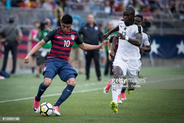 Joe Corona of US Men's National Team stops the ball and keeps control against Issac Sackey of the Ghana National Team during the International...
