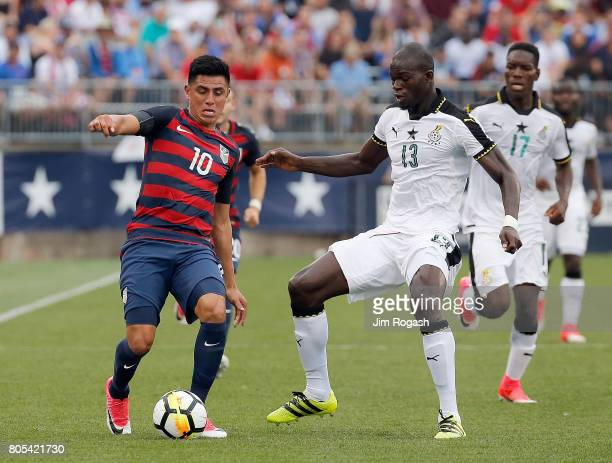 Joe Corona United States gets by Isaac Sackey of Ghana in the first half during an international friendly between USA and Ghana at Pratt Whitney...