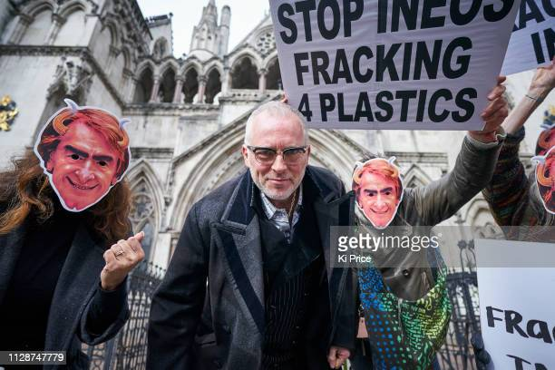 Joe Corre with protesters wearing masks of INEOS CEO Jim Ratcliffe at The High Court on in London England The British businessman and environmental...
