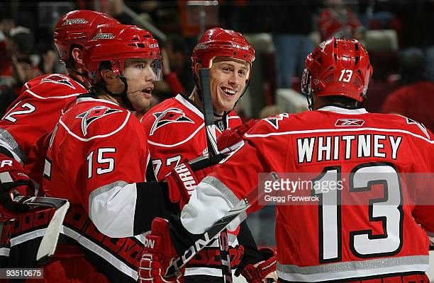 Joe Corvo of the Carolina Hurricanes celebrates his first period goal with teammates Eric Staal, Tuomo Ruutu and Ray Whitney during a NHL game...