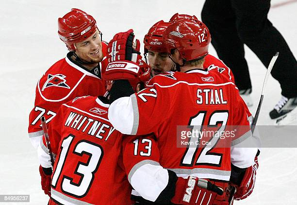 Joe Corvo of the Carolina Hurricanes celebrates his second goal with Ray Whitney, Tuomo Ruutu and Eric Staal during the game against the Tampa Bay...