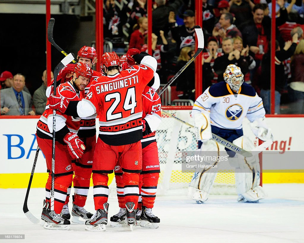 Joe Corvo #77 of the Carolina Hurricanes celebrates with teammates after scoring a goal against Ryan Miller #30 of the Buffalo Sabres during play at PNC Arena on March 5, 2013 in Raleigh, North Carolina.