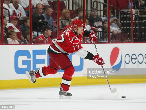Joe Corvo of the Carolina Hurricanes passes the puck during Game Four of the Eastern Conference Quarterfinal Round of the 2009 Stanley Cup Playoffs...