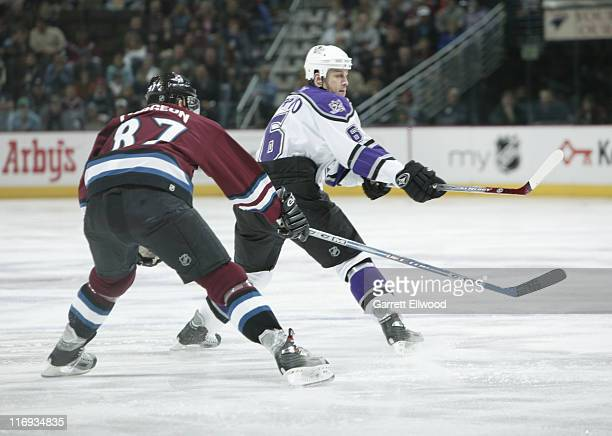 Joe Corvo of the Los Angeles Kings and Pierre Turgeon of the Colorado Avalanche in action on December 28, 2005 at Pepsi Center in Denver, Colorado.