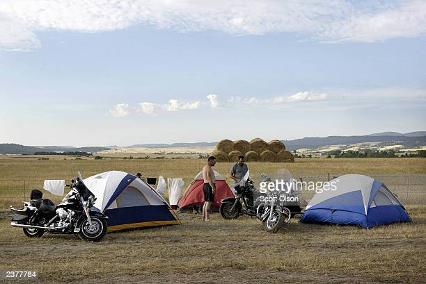 Joe Covington and Munster of Richmond Virginia look over a motorcycle at their campsite during the annual Sturgis Motorcycle Rally August 7 2003 near...
