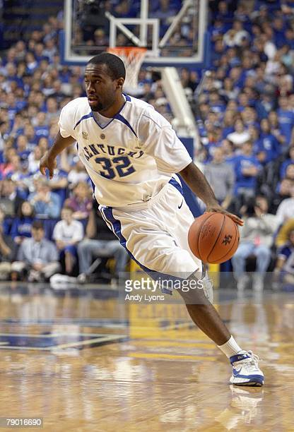 Joe Crawford of the Kentucky Wildcats dribbles the ball during the SEC game against the Vanderbilt Commodores at Rupp Arena January 12 2008 in...