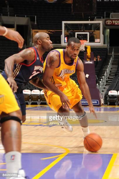 Joe Crawford of the Los Angeles DFenders dribbles against Mateen Cleaves of the Bakersfield Jam at Staples Center on December 14 2008 in Los Angeles...
