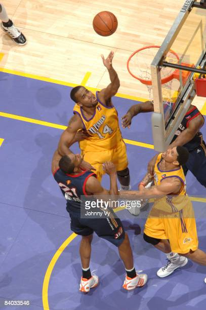 Joe Crawford of the Los Angeles DFenders goes up for a shot against DeMarcus Nelson of the Bakersfield Jam at Staples Center on December 14 2008 in...