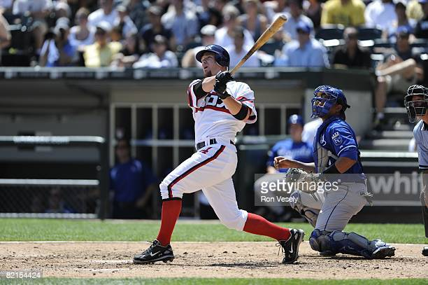 Joe Crede of the Chicago White Sox hits a three run home run during the game against the Kansas City Royals at US Cellular Field in Chicago Illinois...