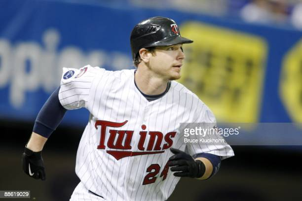 Joe Crede of the Minnesota Twins runs to first against the Pittsburgh Pirates on June 18 2009 at the Metrodome in Minneapolis Minnesota The Twins won...