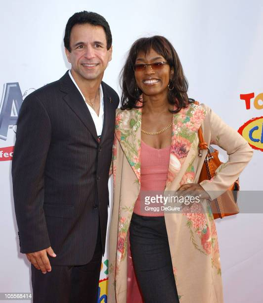 Joe Cristina and Angela Bassett during 2004 Dream Halloween Fundraiser For Children Affected by AIDS Foundation at Barker Hangar in Santa Monica...
