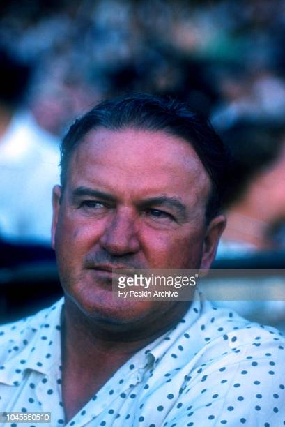 Joe Cronin, general manager of the Boston Red Sox sits in the crowd during an MLB Spring Training game against the Brooklyn Dodgers circa March, 1956...
