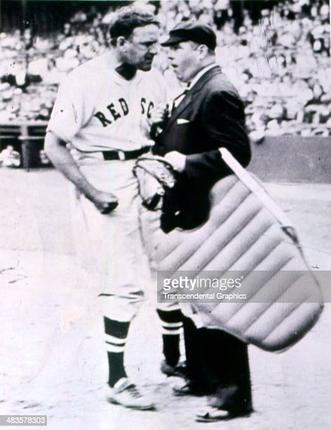 Joe Cronin, shortstop for the Boston Red Sox gives the umpire an earful during a game in 1939 in Fenway Park in Boston, Massacusetts.