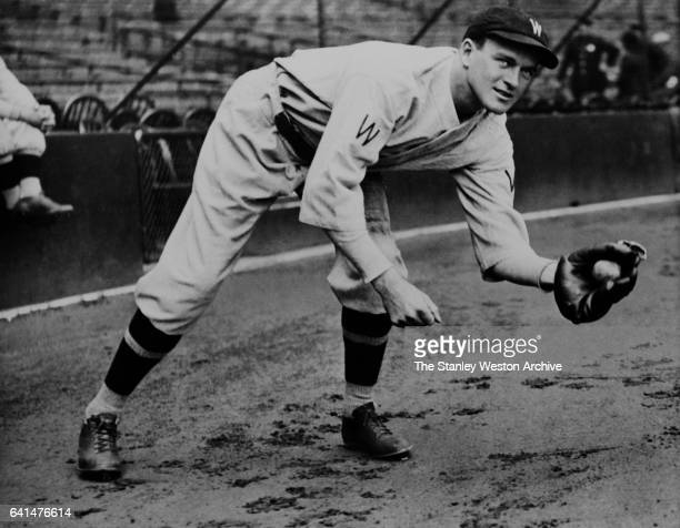 Joe Cronin, shortstop of the Washington Senators, grabs a ground ball, circa 1930.